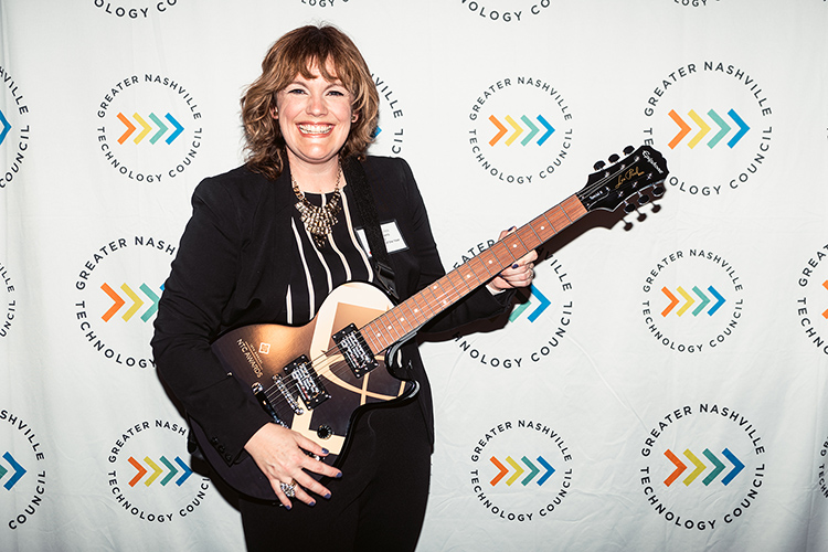 Middle Tennessee State University business intelligence and analytics professor Amy Harris holds the signature guitar-themed award from the Greater Nashville Technology Council Diversity as winner of the Inclusion Advocate of the Year Award at the 12th Annual NTC Awards ceremony was held in April from Stage Post Studios in Nashville, Tenn., as a hybrid in-person and virtual event. (Photo courtesy of Nathan Zucker)