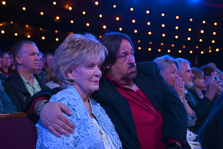 Hazel Daniels, left, widow of country music legend Charlie Daniels, watches with Charlie Daniels Jr. during a tribute to the icon at the Grand Ole Opry as part of Saturday's sold-out Opry Salute the Troops show in Nashville, Tenn. (MTSU photo by James Cessna)