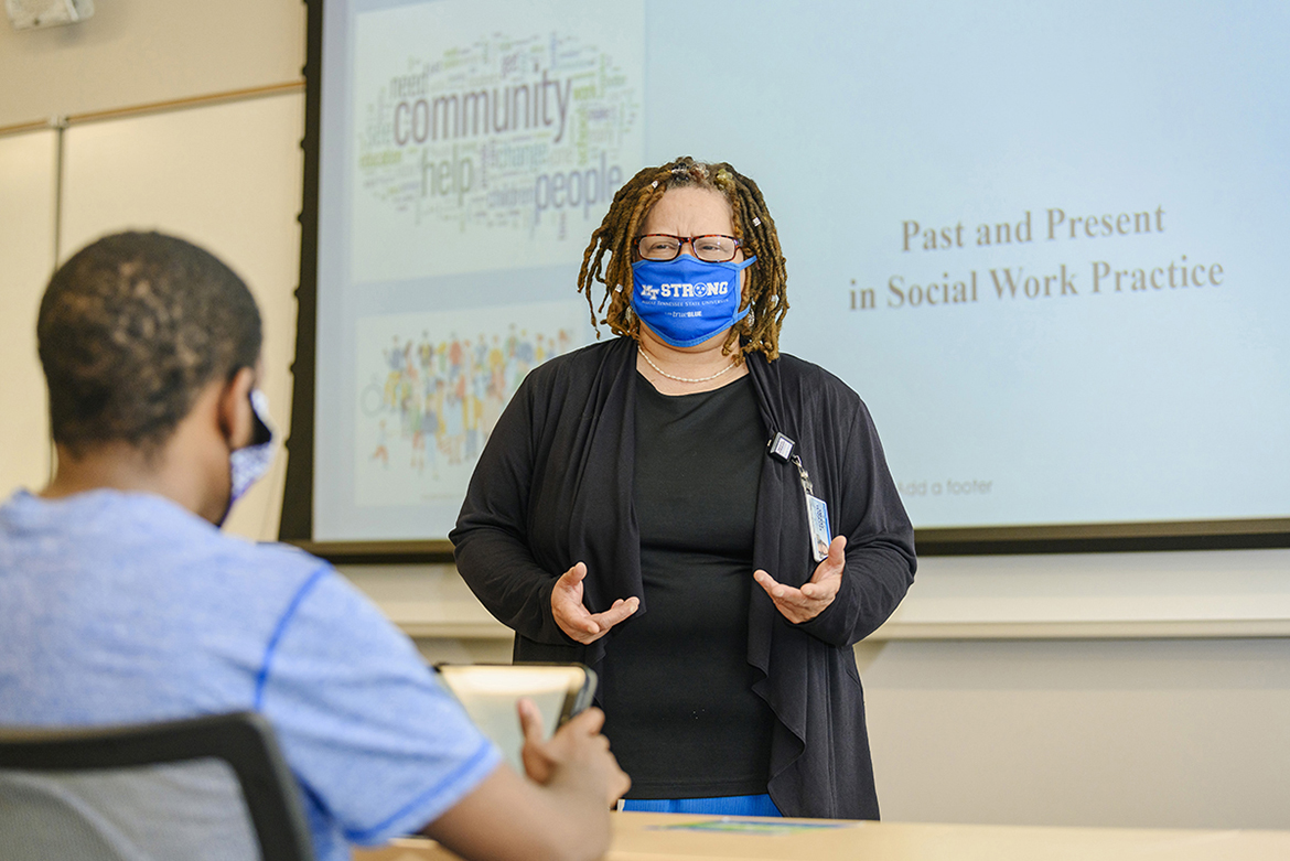 Carmelita Dotson of the Department of Social Work addresses a student in the Academic Classroom Building. (MTSU Photo by J. Intintoli)