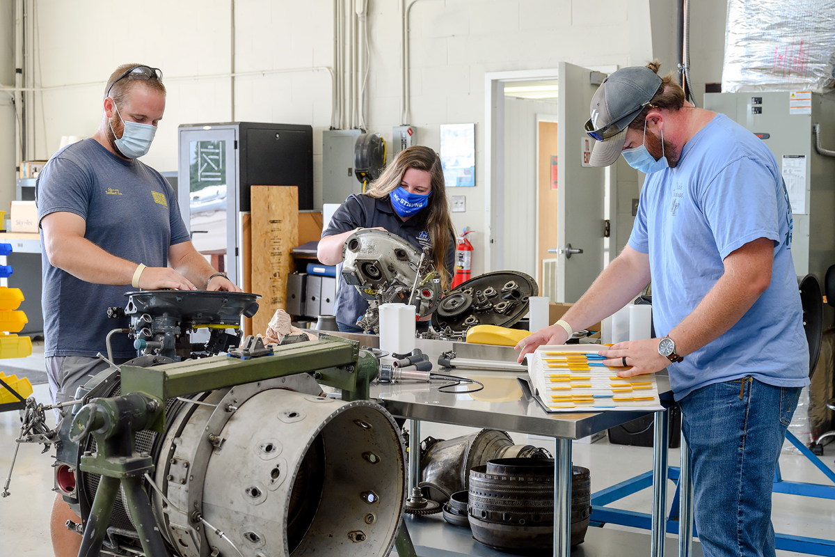 MTSU aerospace maintenance management seniors Brandon Snell, left, Aubrey Vest and Tanner Jones perform training tasks in the Flight Operations Center maintenance hangar at Murfreesboro Airport. They are among five MTSU students who received National Business Aviation Administration Charities scholarships to attend out-of-state training for up to two weeks during the 2020-21 academic year. (MTSU photo by J. Intintoli)