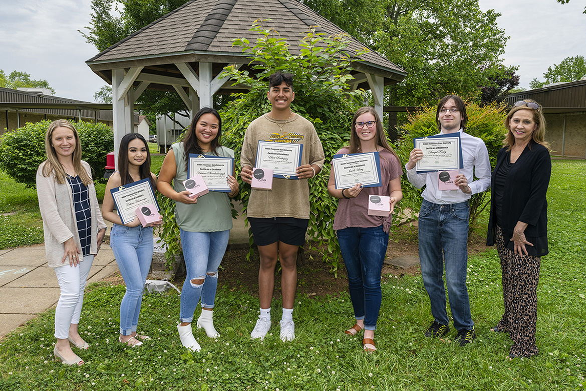 All five Riverdale High School students who took the Nutrition Dual Credit Challenge Exam pose with the certificates showing that they passed the test. From left are Jaime Brown, Riverdale teacher and MTSU alumna; Riverdale students Kaliena Vichitvongsa, Kristina Phanthalangsyk, Eliott Rodriguez, Avery Jewell, and Danyul Fenley; and Janet Colson, professor of nutrition and food science and registered nutrition. (MTSU Photo by Andy Heidt)