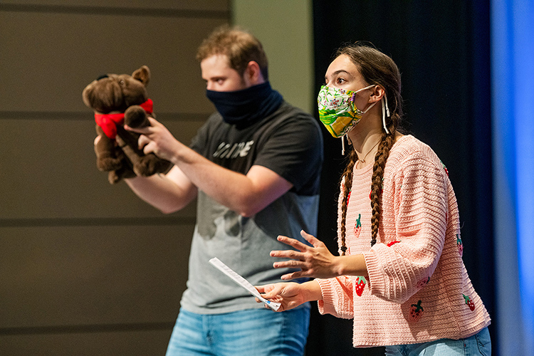 """Middle Tennessee State University students Olivia Hendrix, right, and Grant Woodall, left, perform their play """"Story Bandits,"""" one of many creative performances at the Scholars Week 2021 event in the Student Union Ballroom on April 16, 2021. (MTSU photo by Andy Heidt)"""
