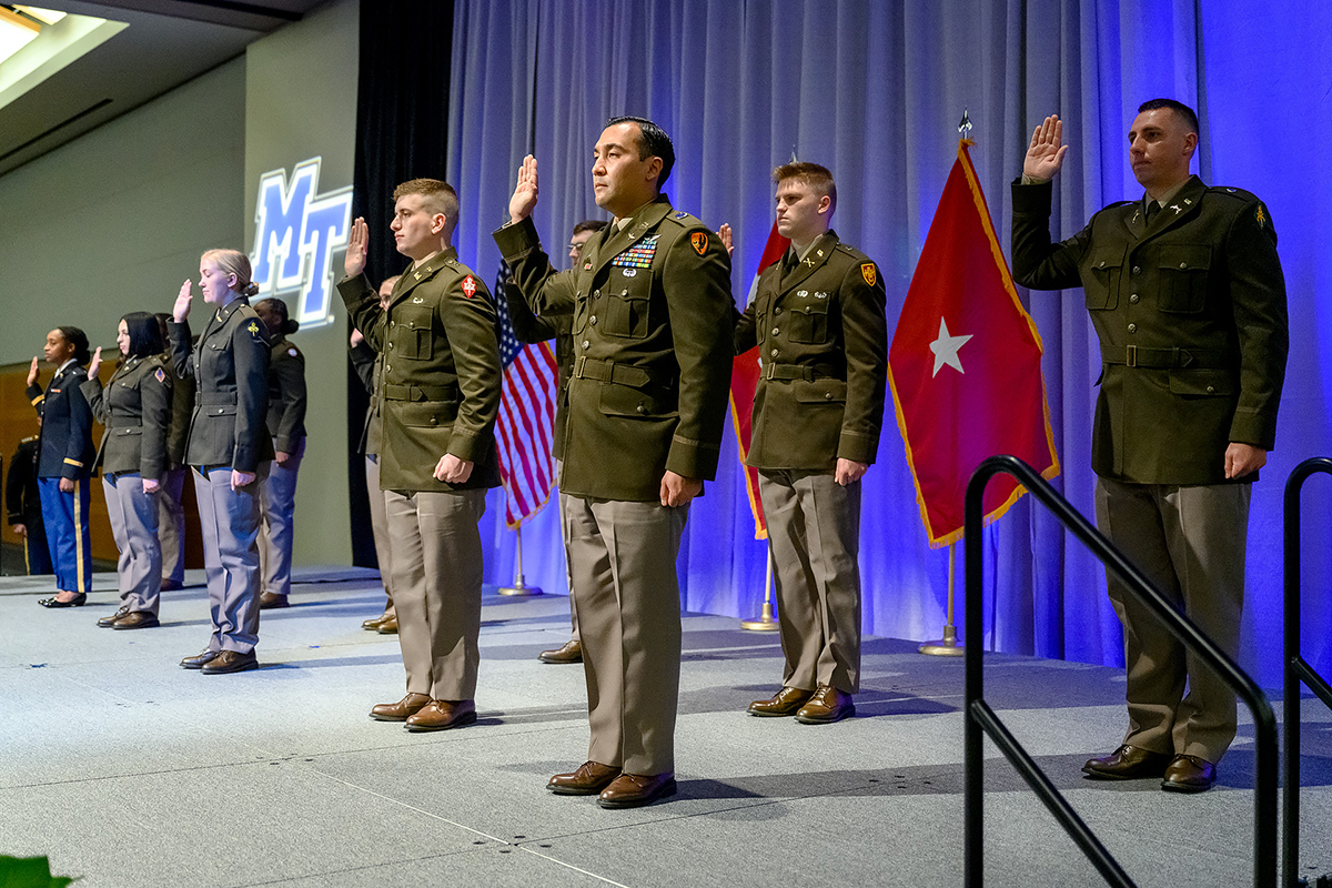 Eleven of the U.S. Army's newest commissioned second lieutenants take the Army Oath, administered by Lt. Col. Carrick McCarthy, an MTSU military science professor who leads the program, Friday, May 7, during the Spring Commissioning Ceremony in the Student Union Ballroom. (MTSU photo by J. Intintoli)