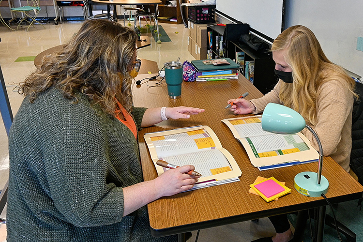 MTSU alumna Stefanie Edgell, left, fifth-grade teacher at Christiana Elementary School who recently won the Teacher of the Year Award, lesson plans with her student teacher, right, in her classroom on March 10, 2021. (MTSU photo by Stephanie Barrette)
