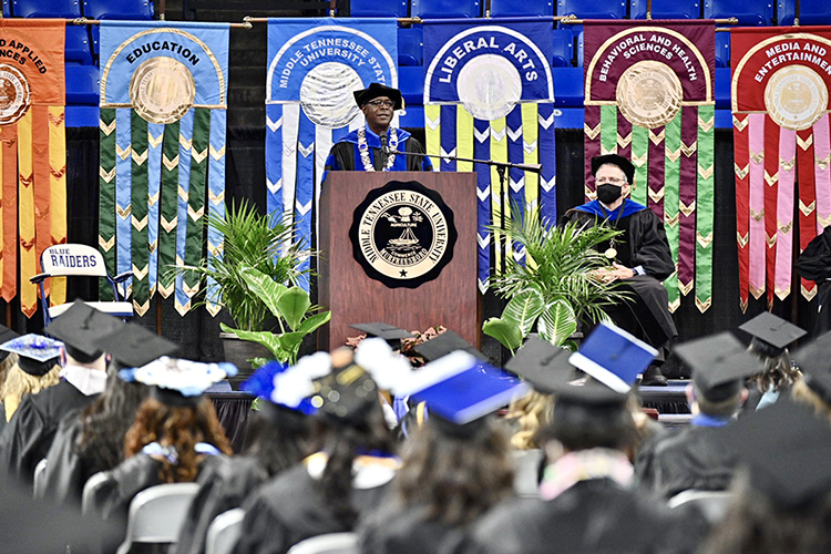 MTSU President Sidney A. McPhee speaks to the Class of 2021 from the stage inside Murphy Center Friday, May 7, at the first of the university's spring 2021 commencement ceremonies as Provost Mark Byrnes listens at right. Students returned to Murphy Center May 7-9 for the first time since 2019 for a three-day, 10-event, socially distanced commencement weekend. (MTSU photo by J. Intintoli)