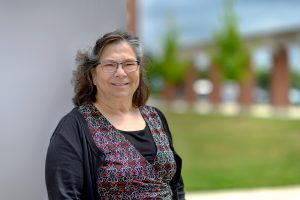 Service to students portrait of Trish Hayes, Social Work at the Academic Classroom Building.