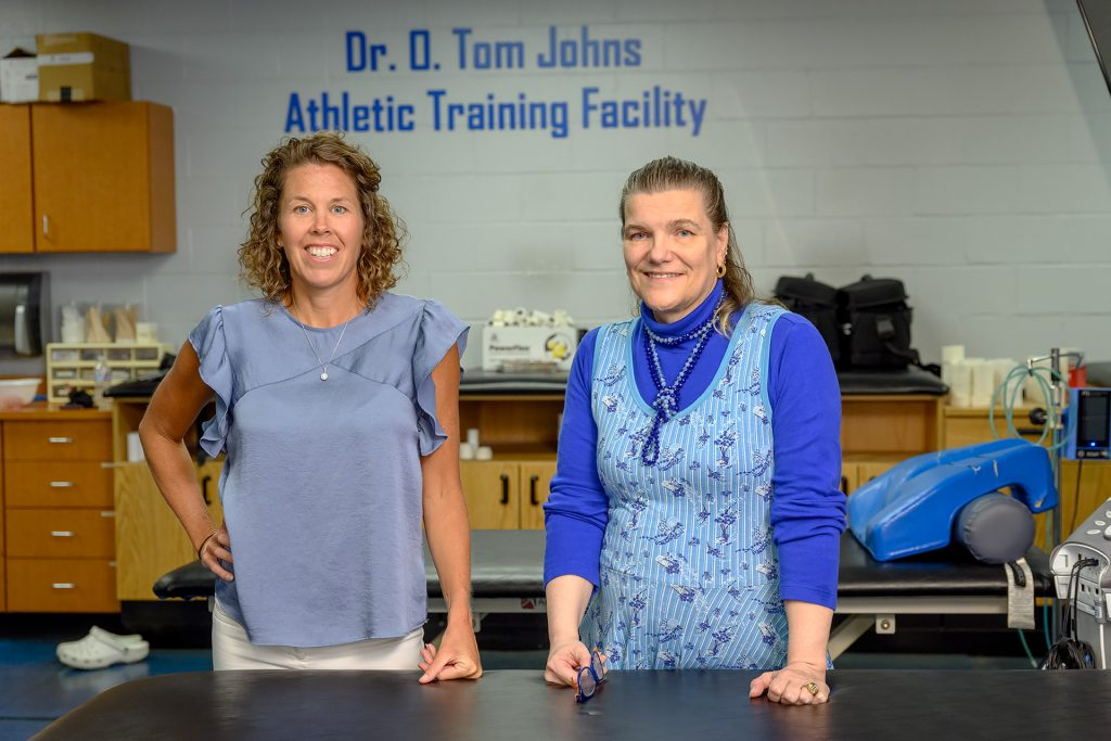 Service to students portrait of Athletic Training faculty Kristi Phillips and Helen Binkley.