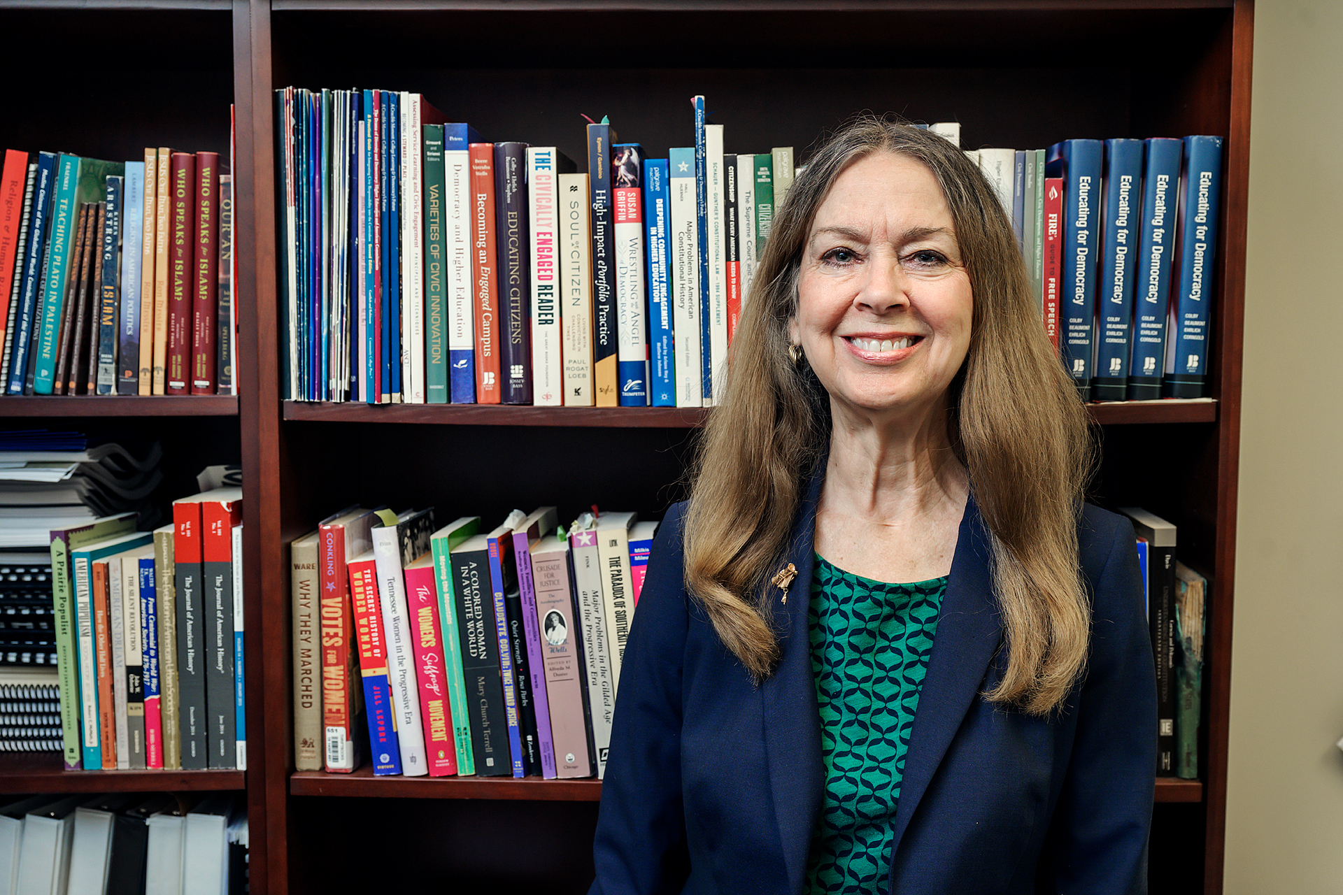 Mary Evins, History Faculty, in and around Paul W. Martin, Sr. Honors College Building. (Photo: Andy Heidt)