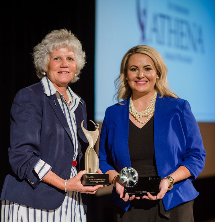 MTSU alumna Meagan Flippin, right, president and CEO of the United Way of Rutherford and Cannon Counties, holds her 2021 ATHENA Young Professional Leadership Award presented to her during a June 3 ceremony at Embassy Suites in Murfreesboro. At left is business owner and mentor Patti James holding her 2021 Rutherford ATHENA Award. (Photo courtesy of Rutherford CABLE)