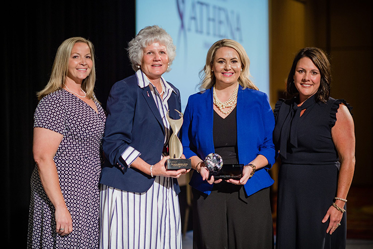 MTSU alumna Meagan Flippin, second from right, president and CEO of the United Way of Rutherford and Cannon Counties, holds her 2021 ATHENA Young Professional Leadership Award presented to her during a June 3 ceremony at Embassy Suites in Murfreesboro. Pictured, from left, are Lori Cutler, 2021 ATHENA co-chair; Patti James, 2021 Rutherford ATHENA Award recipient; Flippin; and Julie Lewis, 2021 ATHENA chair. (Photo courtesy of Rutherford CABLE)