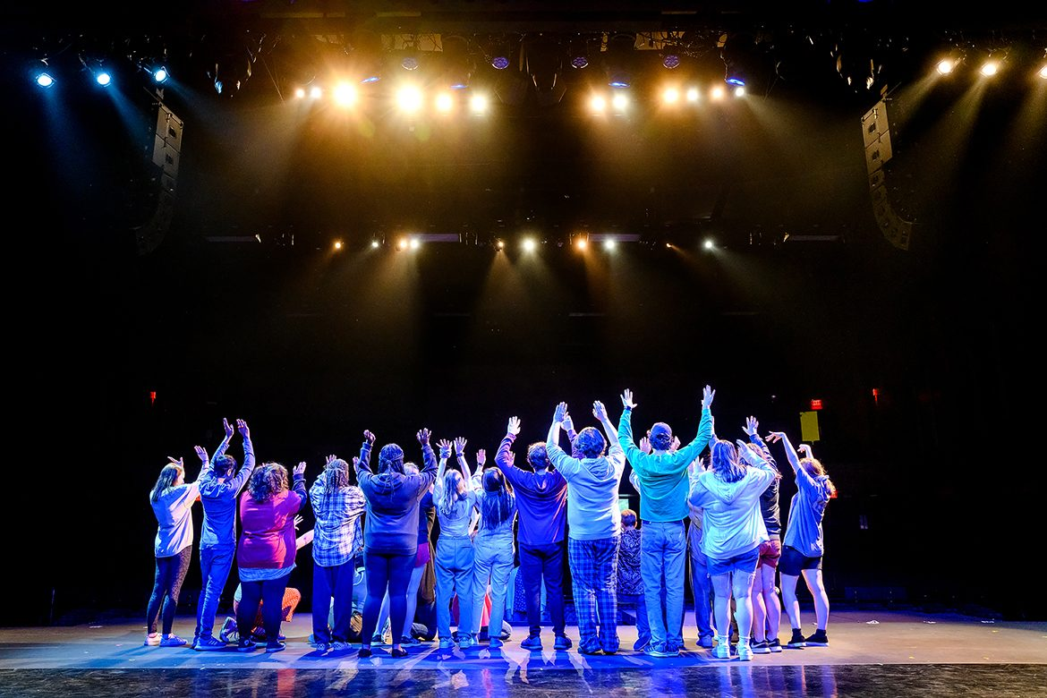 Young theater students attending the 2021 Governor's School for the Arts at MTSU raise their arms and shout in celebration during a June 23 rehearsal on the university's Tucker Theatre stage. Nearly 300 11th and 12th graders from across Tennessee attended the monthlong residency program in person for intensive training in music, theater, visual arts, dance and filmmaking. (MTSU photo by J. Intintoli)