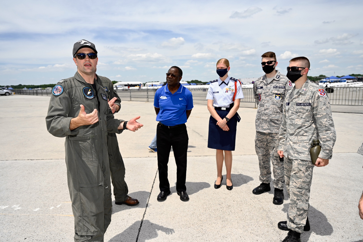 U.S. Navy Lt. Jeff Reider, left, a pilot of the EA-18G Growler, discusses various aspects of the plane to MTSU President Sidney A. McPhee, incoming MTSU freshman criminal justice major Emerson Garfield and two other members of the Civil Air Patrol Murfreesboro Composite Squadron TN 162 Friday, June 4, during practice for the Great Tennessee Air Show in Smyrna, Tenn. Thousands of spectators will watch the show June 5-6. (MTSU photo by J. Intintoli)