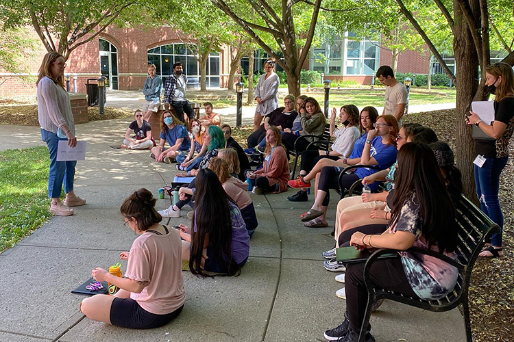 Deana Raffo, director of the MTSU Institute of Leadership Excellence and management professor, talks to 2021 ILE students in the courtyard of the Business and Aerospace Building. This year's institute was held May 17-21. (Submitted photo)
