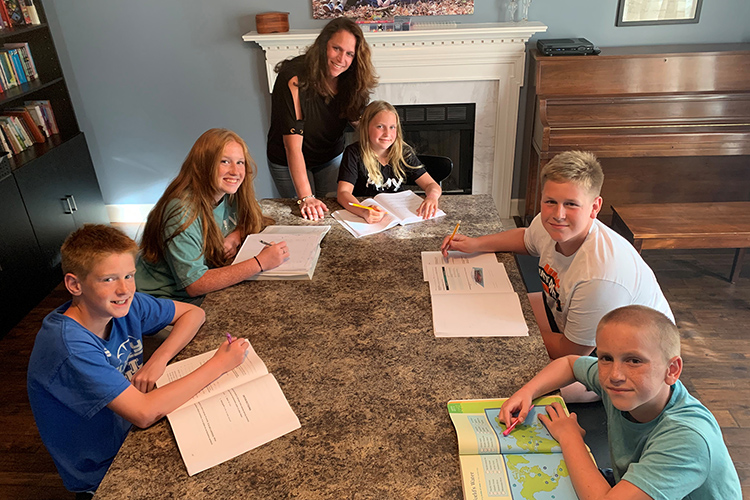 MTSU adult learner Julie Witt of Old Hickory, Tenn., standing, homeschools five of her children as she also pursues completion of her bachelor's degree in integrated studies after two decades away from the classroom. Pictured with her at their home, from bottom left, are Lincoln, 13; Clara, 16; Noelle, 9; Barrett, 15; and Kenny, 11. (Submitted photo)