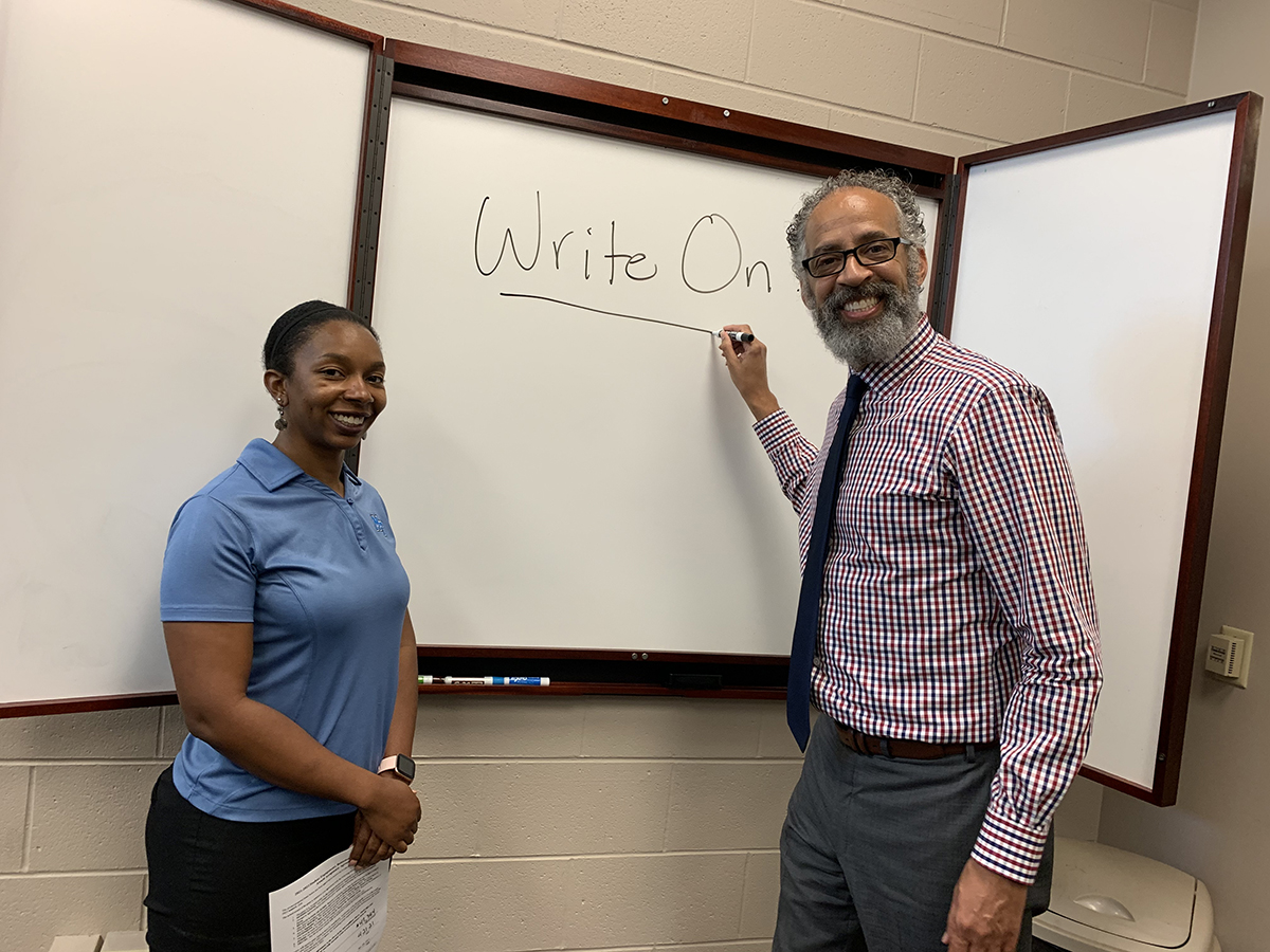Brelinda Johnson, left, Scholars Academy manager in the MTSU Office of Student Success, and Vincent Windrow, associate vice provost, are excited to learn two TBR grants for TBR Student Engagement, Retention and Success Grant Awards for writing and peer mentoring are among six altogether received by MTSU faculty members across campus. Combined, they are worth more than $162,000 to help underserved students this coming fall and spring semesters. (MTSU photo by Randy Weiler)