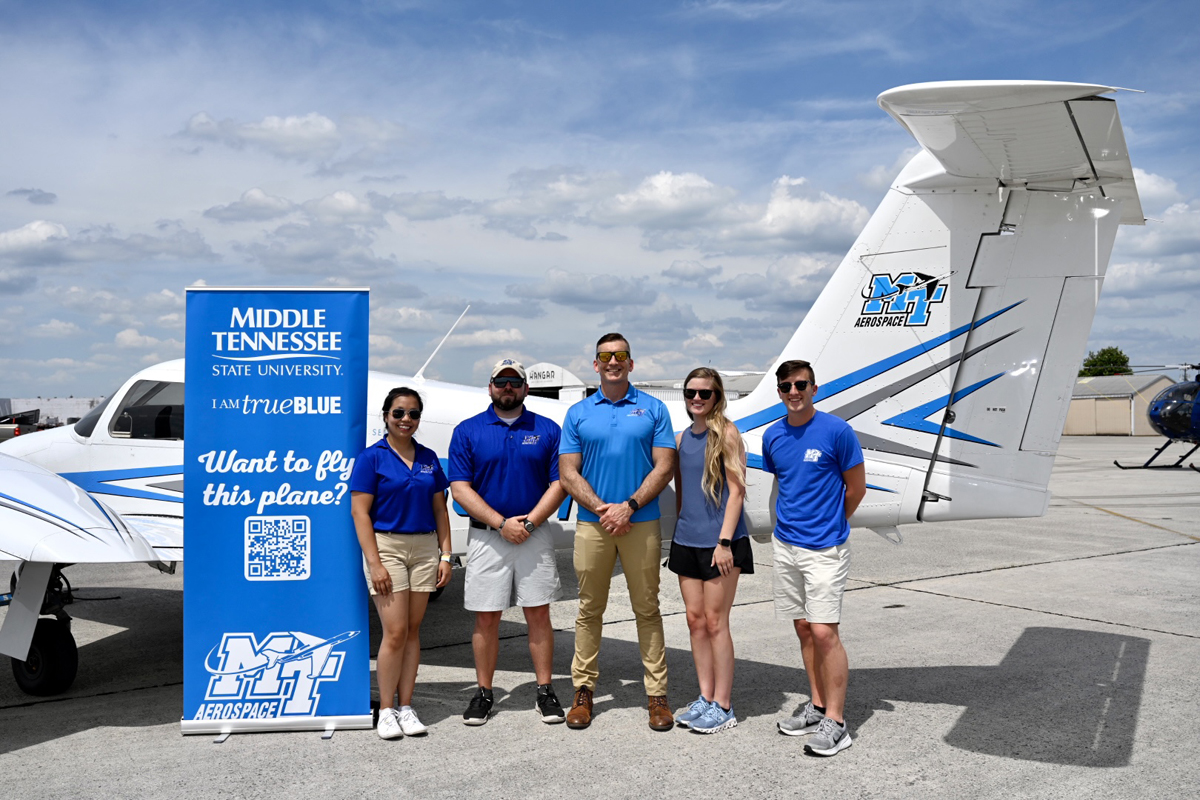 MTSU is the presenting sponsor at the 2021 Great Tennessee Air Show in Smyrna, Tenn., June 5-6. On hand for the Friday, June 4, practice and visit with U.S. Navy pilots were MTSU flight instructors Nakanya Rodruepid, left, and Dillon Beckwith, aerospace associate professor Nate Callender and flight instructors Lauren Franks and Nick Phillips. (MTSU photo by J. Intintoli)
