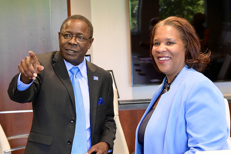 MTSU President Sidney A. McPhee shows Nashville State Community College President Shanna L. Jackson images of various campus buildings on display in a conference room in the Cope Administration Building on the Murfreesboro campus. (MTSU photo by Andrew Oppmann)