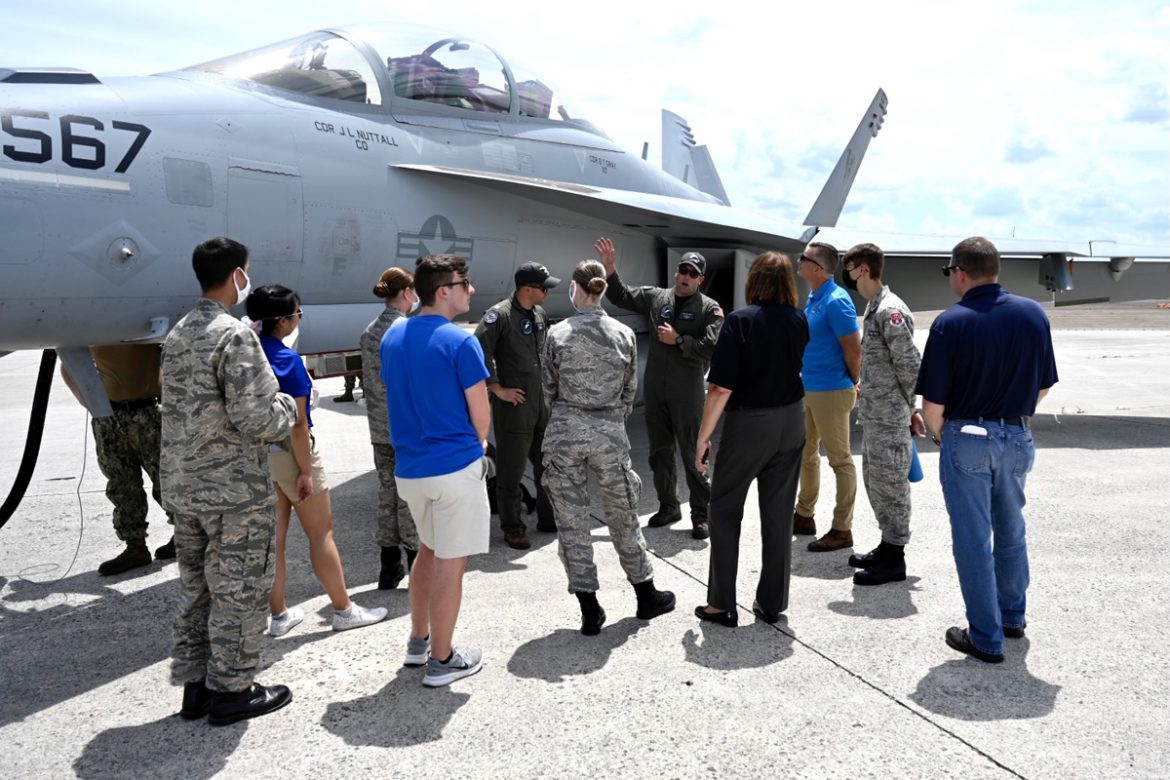 U.S. Navy Lt. Thomas Demonbreun, a Murfreesboro native with family ties to MTSU, explains various aspects of the EA-18G Growler he flies in air shows and helps train future pilots. His Navy VAQ-129 Squadron is participating in the Great Tennessee Air Show at Smyrna, Tenn., June 5-6. (MTSU photo by J. Intintoli)