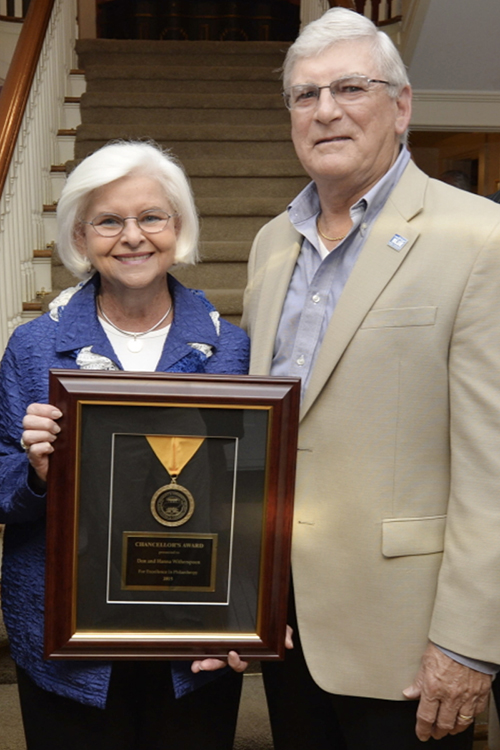 MTSU alumni Hanna, left, and Don Witherspoon accept an award for their assistance to the university at a reception for supporters of the MTSU Centennial Campaign at the President's House in this 2015 file photo. Don Witherspoon has established a new scholarship to pay tribute to his wife's work in the MTSU library during their student days. (MTSU file photo by Andy Heidt)