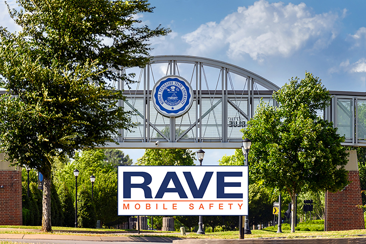 This file image shows the Blue Raider Bridge, connecting MTSU's Student Union and Student Services and Admissions Center, and the crosswalk for pedestrians below on Blue Raider Drive, plus the Rave Mobile Safety logo superimposed onto the photo. (MTSU file photo by J. Intintoli)