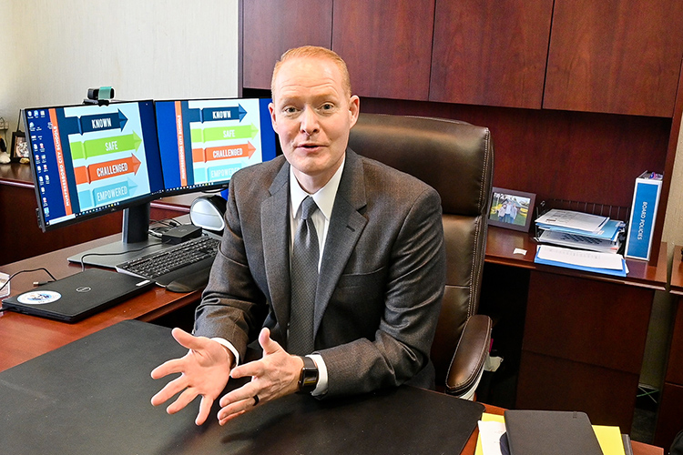 New Murfreesboro City Schools Director Trey Duke, who recently earned his third degree from Middle Tennessee State University in May, explains how MCS is proud to have MTSU graduates as part of their school district family in his office on March 11, 2021. (MTSU photo by Stephanie Barrette)