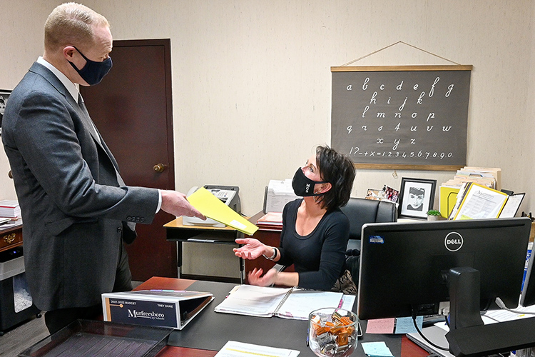 Trey Duke, director of Murfreesboro City Schools and three-time Middle Tennessee State University graduate, meets with Lisa VanCleave, his administrative assistant, outside of his office on March 11, 2021. (MTSU photo by Stephanie Barrette)