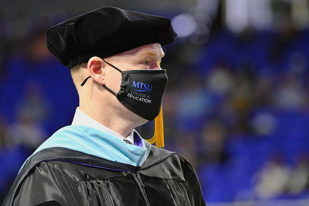 Murfreesboro City Schools Director Trey Duke prepares to accept his degree during MTSU's Spring Commencement held May 8, 2021, inside Murphy Center. Duke graduated with his third degree from Middle Tennessee State University, a doctorate in K-12 assessment, learning and student success. (MTSU photo by Stephanie Barrette)