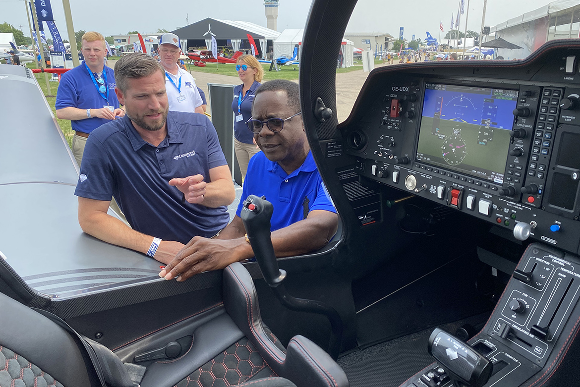 Diamond Aircraft CEO Scott McFadzean, left, shows MTSU President Sidney A. McPhee an advanced DA-50 aircraft in front of company's booth on the grounds of the EAA AirVenture 2021, which runs July 26-Aug. 1 in Oshkosh, Wisc. Diamond Aircraft is the fleet supplier for the university, which also set up booth promoting its Aerospace Department. (MTSU photo by Andrew Oppmann)