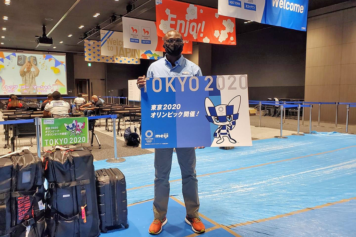 Dr. Andrew Owusu, assistant professor of health and human performance and adviser to Ghana's men's track and field team, poses at the airport in Tokyo, Japan, site of the 2021 Summer Olympics. (Photo provided)