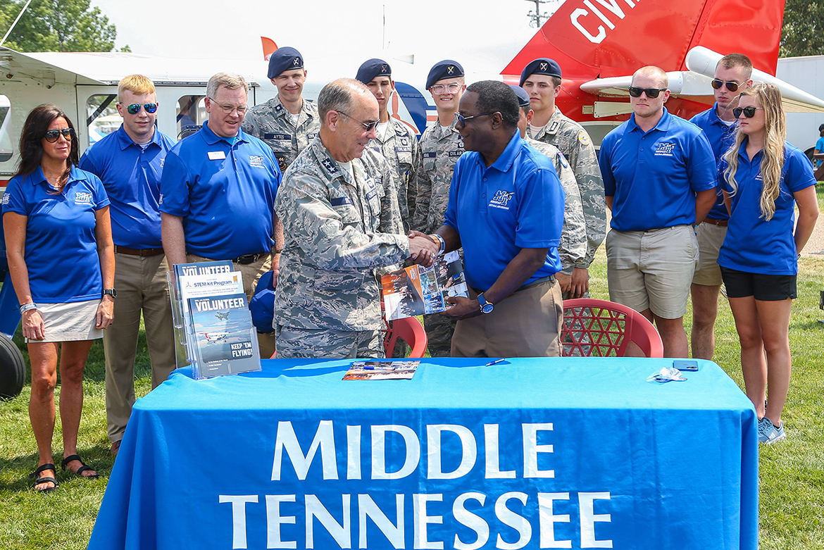 Middle Tennessee State University and Civil Air Patrol renew their partnership Monday, July 26, at EAA AirVenture 2021 in Oshkosh, Wisc. MTSU President Sidney A. McPhee, right, and Maj. Gen. Mark Smith, CAP's national commander and chief executive officer, signed the three-year extension just hours after the Experimental Aircraft Association's signature annual event roared back after a one-year COVID-19 hiatus. MTSU's close ties with CAP stretch back to July 1948, the year CAP's Middle Tennessee State College Squadron was organized. (U.S. Air Force Auxiliary photo by Lt. Col. Robert Bowden)