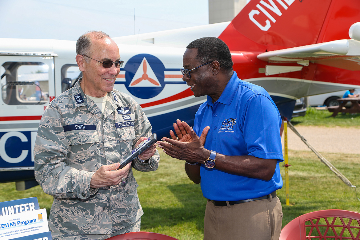 Maj. Gen. Mark Smith, left, Civil Air Patrol's national commander and chief executive officer, presents Middle Tennessee State University President Sidney A. McPhee with a plaque Monday, July 26, recognizing the university as CAP's Tennessee Wing's top aerospace education partner in 2020. COVID-19 precautions prevented CAP from presenting the honor in person last year. MTSU and Civil Air Patrol renewed their partnership Monday at EAA AirVenture 2021 in Oshkosh, Wisc., just hours after the Experimental Aircraft Association's signature annual event roared back after a one-year COVID-19 hiatus. (U.S. Air Force Auxiliary photo by Lt. Col. Robert Bowden)