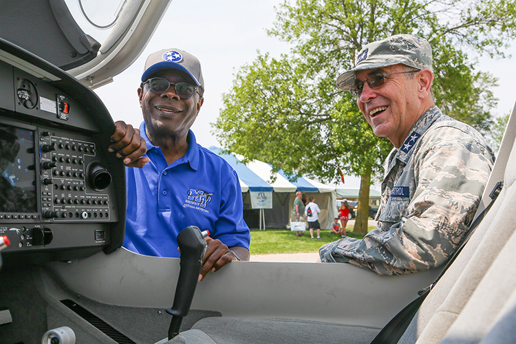Middle Tennessee State University President Sidney A. McPhee, left, and Maj. Gen. Mark Smith, Civil Air Patrol's national commander and chief executive officer, inspect one of the university's Diamond Aircraft Monday, July 26, on the grounds of the EAA AirVenture 2021 in Oshkosh, Wisc. MTSU and CAP signed a three-year extension of their partnership just hours after the Experimental Aircraft Association's signature annual event roared back after a one-year COVID-19 hiatus. (U.S. Air Force Auxiliary photo by Lt. Col. Robert Bowden)