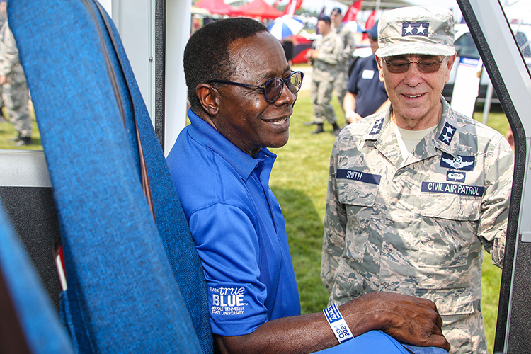 Middle Tennessee State University President Sidney A. McPhee, left, and Maj. Gen. Mark Smith, Civil Air Patrol's national commander and chief executive officer, inspect one of the CAP aircraft Monday, July 26, on the grounds of the EAA AirVenture 2021 in Oshkosh, Wisc. MTSU and CAP signed a three-year extension of their partnership. (U.S. Air Force Auxiliary photo by Lt. Col. Robert Bowden)
