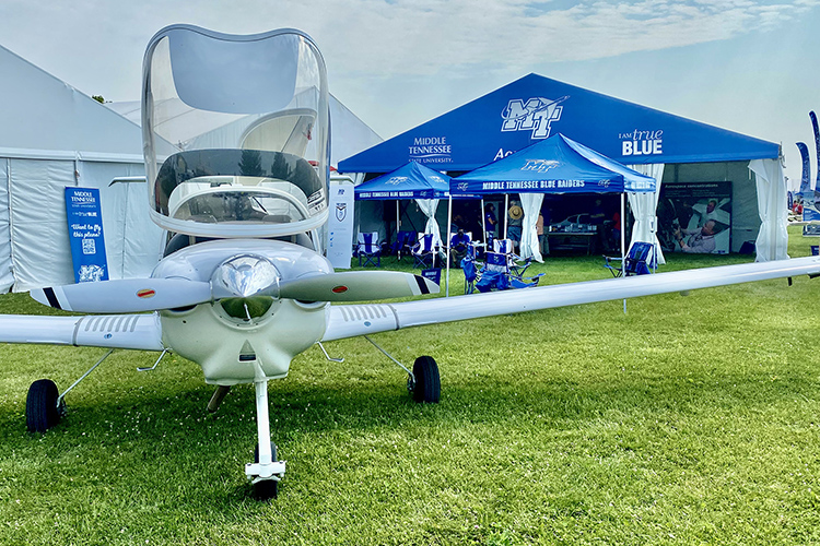 MTSU's Aerospace Department has one of its Diamond Aircraft on display Monday, July 26, at its booth set up on the grounds of the EAA AirVenture 2021 event, which runs this week in Oshkosh, Wisc. (MTSU photo by Andrew Oppmann)