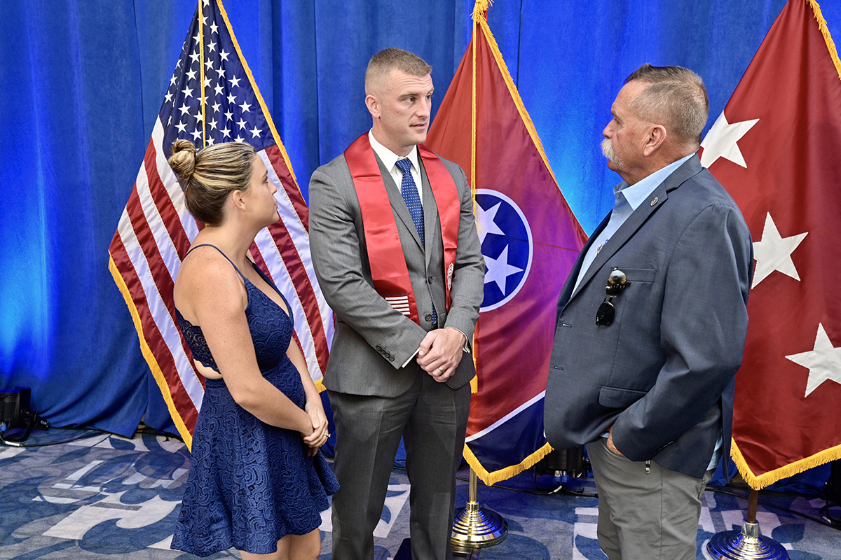 Brienanna, left, and Corbitt Huseth visit with David Corlew of The Journey Home Project following the Graduating Veterans Stole Ceremony Wednesday, July 28, in the Ingram Building's MT Center on the MTSU campus. Corbitt Huseth, who will earn his doctorate in human performance, will be the first graduating student veteran to receive a third stole for earning his third degree. Brie Huseth will be pursuing a master's degree in education at MTSU starting this fall. (MTSU photo by Andy Heidt)