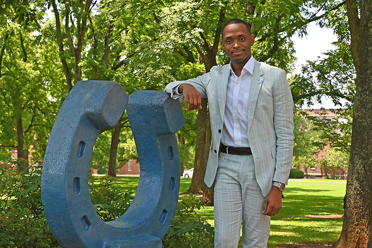 New MTSU Student Government Association President Winton Cooper poses next to the blue horseshoe in Walnut Grove July 14, 2021, on the Middle Tennessee State University campus in Murfreesboro, Tenn. (MTSU photo by Jimmy Hart)