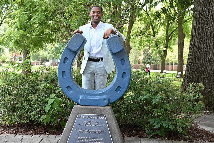 New MTSU Student Government Association President Winton Cooper poses behind the blue horseshoe in Walnut Grove July 14, 2021, on the Middle Tennessee State University campus in Murfreesboro, Tenn. (MTSU photo by Jimmy Hart)