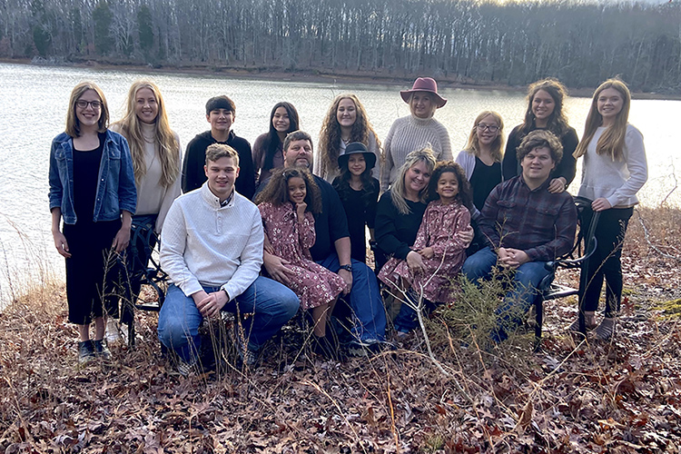 The Solomon family pose for a family portrait at Paris Landing State Park located in Buchanan, Tennessee, in Henry County on Jan. 1, 2021. Standing, from left, are Gabby, Thomas, Alicia, Leah, Caroline, Zoe, Hailey and Ciara. Sitting, from left, are Andrew, Avi Grace, Steve, Scarlett, Gretchen, Aveena and Blake. (Photo provided by Gretchen Solomon)