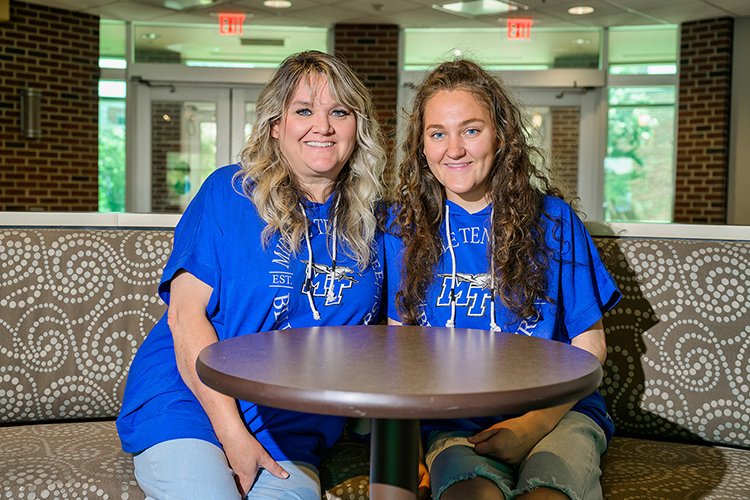 Leah Solomon, Middle Tennessee State University student, right, and Gretchen Solomon, MTSU education alumna, left, sit together inside the university's College of Education on June 30, 2021, where Leah, inspired by her mother Gretchen, pursues a career in early childhood special education. (MTSU photo by Andy Heidt)