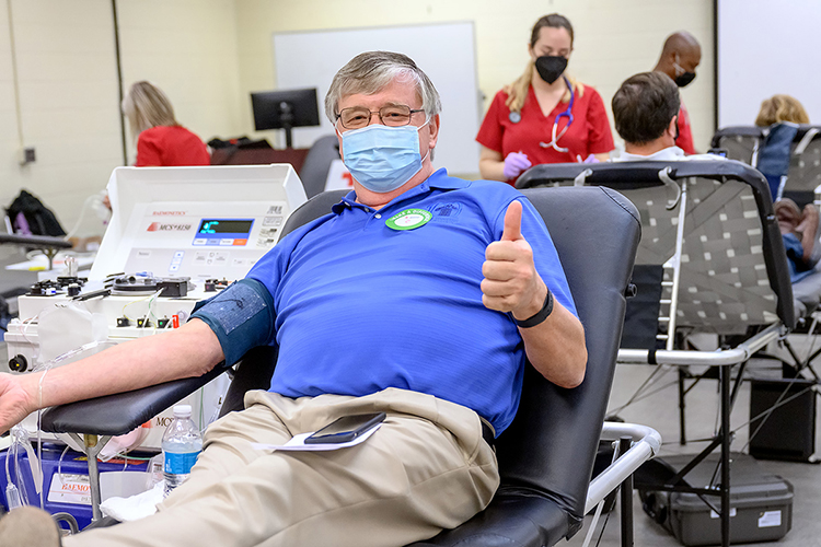 """Tom Wallace, MTSU associate vice-president for information technology, gives a thumbs-up while waiting to donate a pint of blood at the university's annual """"Battle of the Branches"""" blood drive Sept. 2 in the Keathley University Center. Donors from across the campus and surrounding community gave 80 pints of blood to help as many as 225 people across the region and state. (MTSU photo by J. Intintoli)"""