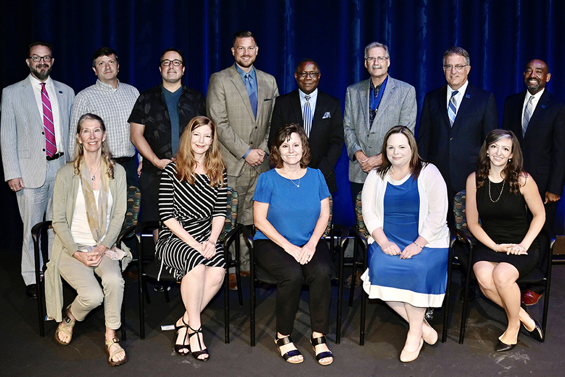 MTSU faculty members gather for a group photo with university leaders Thursday, Aug. 19, after they were recognized by the MTSU Foundation with awards for their service at the 2021 Fall Faculty Meeting in Tucker Theatre. The recipients and their honors include, seated front row from left, biology professor Kim Cleary Sadler, Outstanding General Education Award; Meg Brooker of the Department of Theatre and Dance, Distinguished Creativity Award; Department of University Studies professor Dianna Z. Rust, Outstanding Teaching Award; Amy Elleman of the Department of Elementary and Special Education, Distinguished Research Award; and psychology professor Tiffany D. Rogers, Outstanding Teaching Award. Standing from left are University Honors College Associate dean and English professor Philip E. Phillips, Distinguished Research Award; finance professor Keith Jacks Gamble and Frank P. Lambert of the Womack Educational Leadership Department, Outstanding Achievement in Instructional Technology Awards; criminal justice administration professor Ben Stickle, Distinguished Research Award; MTSU President Sidney A. McPhee; Career Achievement Award winner Timothy Graeff of the Department of Marketing; MTSU Provost Mark Byrnes; and alumnus and MTSU Foundation Vice President Ronald Roberts. Not pictured is recording industry professor Odie Blackmon, who received an Outstanding Teaching Award. Details on each of the professors' accomplishments are available at http://ow.ly/rcYE30rRunA. (MTSU photo by Andy Heidt)
