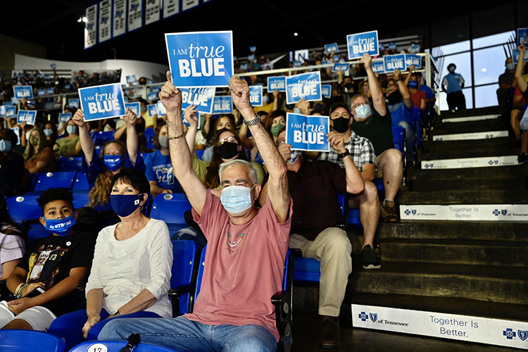 New MTSU freshmen, transfer students and their families and supporters hold up True Blue signs for a photo to commemorate the 2021 University Convocation held Saturday, Aug. 21, at Murphy Center. (MTSU photo by J. Intintoli)