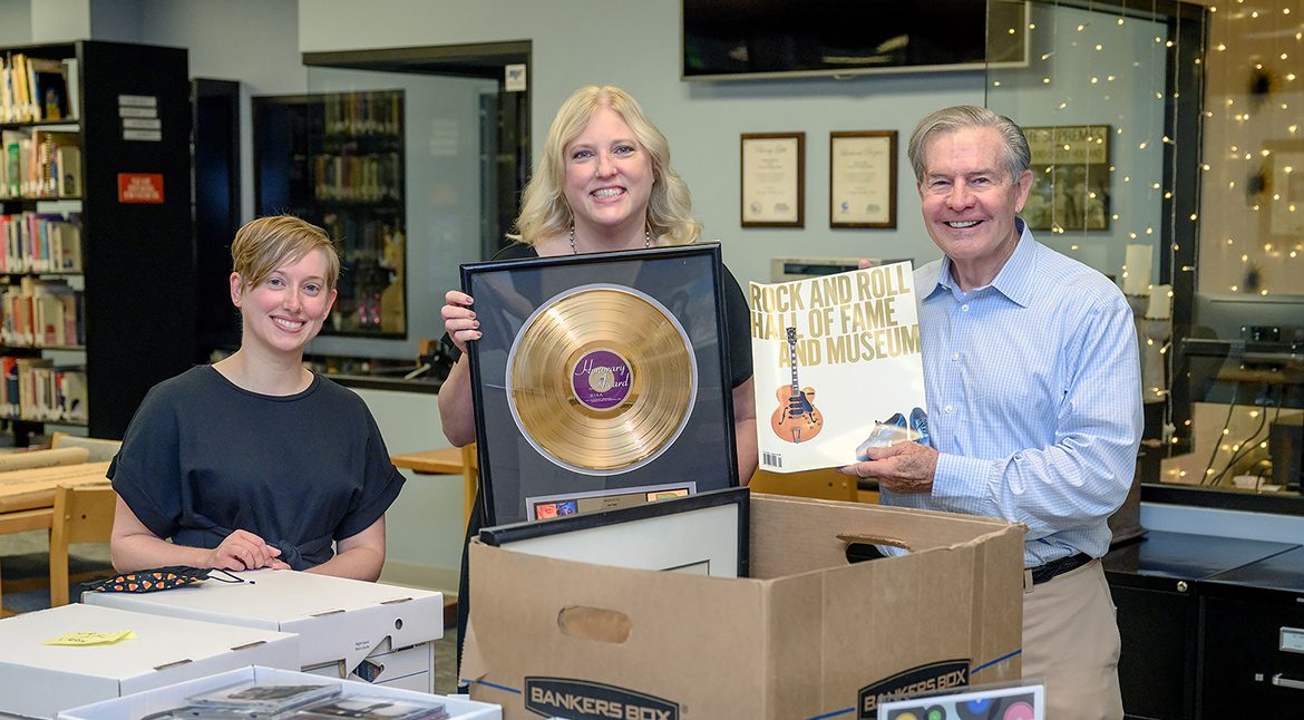 MTSU alumnus Jim Free, right, a member of the Country Music Association board, shows the musical memorabilia he collected from his decades in show business to archivist Rachel Morris, left, and Beverly Keel, dean of the College of Media and Entertainment on Monday, Aug. 16, inside the Center for Popular Music in the university's Bragg Building. Free donated ticket stubs, event programs, and other artifacts to the CPM. (MTSU Photo by J. Intintoli)