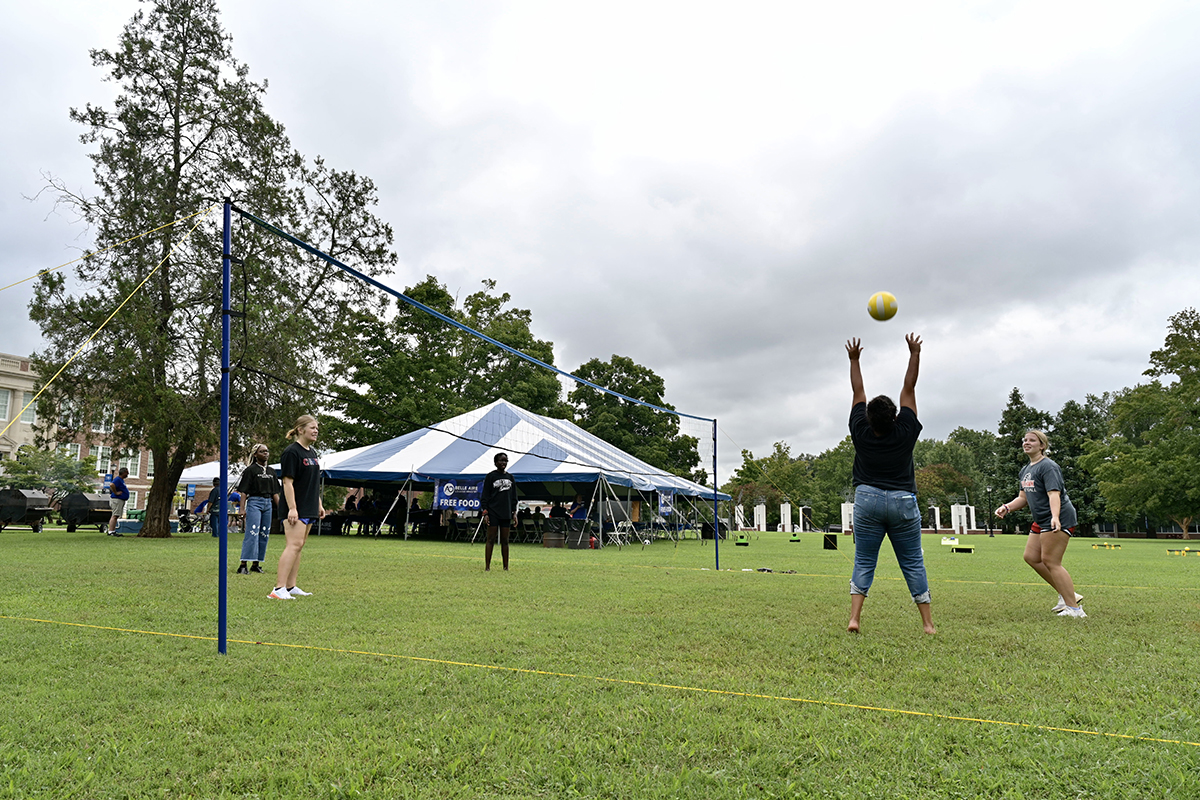 Old and new friends enjoy playing volleyball and other games at the Move-in Mixer Friday, Aug. 20, in Walnut Grove on the MTSU campus. New and returning students have been moving in to campus housing this week ahead of the Saturday, Aug. 21, Convocation and Monday, Aug. 23, first day of classes. Volunteers from Belle Aire Baptist Church provided free food for students, staff and faculty for two days. (MTSU photo by Andy Heidt)