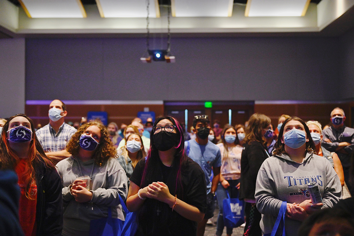 Prospective MTSU students and their parents watch a video during the kickoff event for the True Blue Tour recently in the Student Union Ballroom on campus. Campus officials visit 14 cities in four states during the fall recruiting season. (MTSU photo by Cat Curtis Murphy)