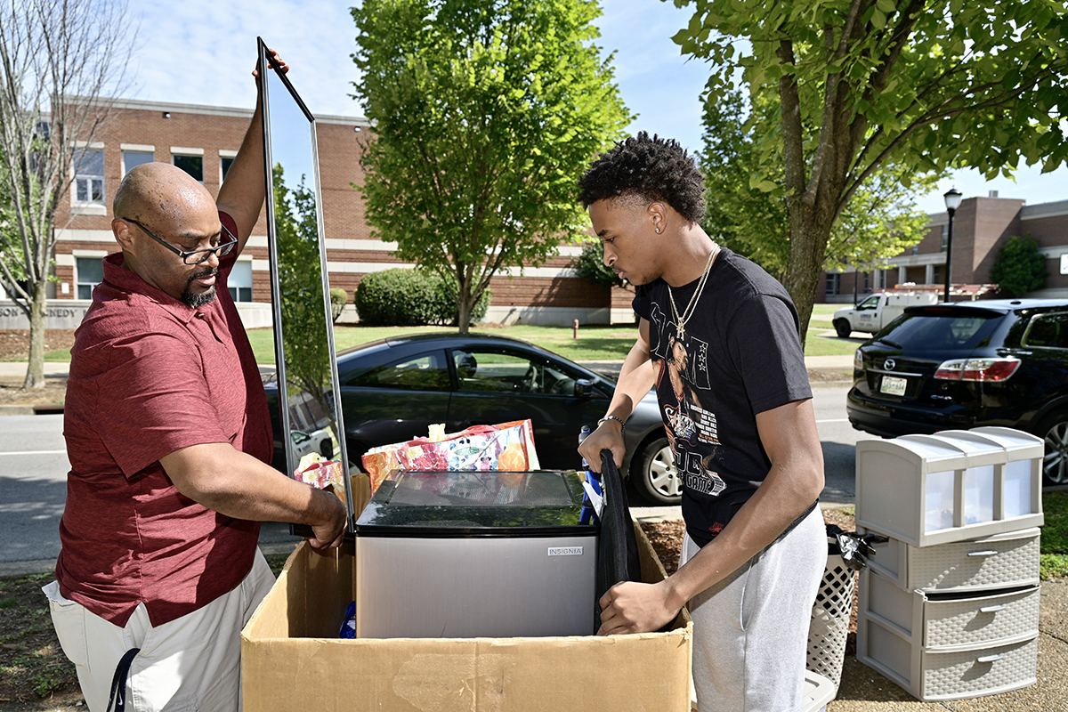 Jarrold Tatum, left, of Cane Ridge, Tenn., places a mirror into a large box and son Justin Tatum adds another item during the new MTSU student's move in to Corlew Hall Wednesday, Aug. 18. Students continue moving in to campus housing during designated times through Saturday afternoon. Nearly 3,000 students will be in university housing this fall. (MTSU photo by Andy Heidt)