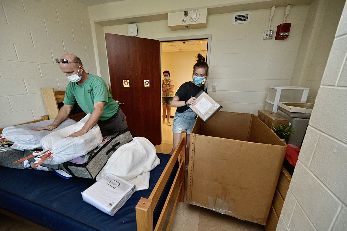Isabella Campbell, right, an MTSU freshman from Franklin, Tenn., and her father Russ Campbell take items out of a large container used to haul her personal belongings in her Corlew Hall room earlier this week, as her mother, Andrea, waits. Isabella Campbell will major in English and international relations and minor in Portuguese and Spanish. Nearly 3,000 students will be moving into campus housing. (MTSU photo by Andy Heidt)