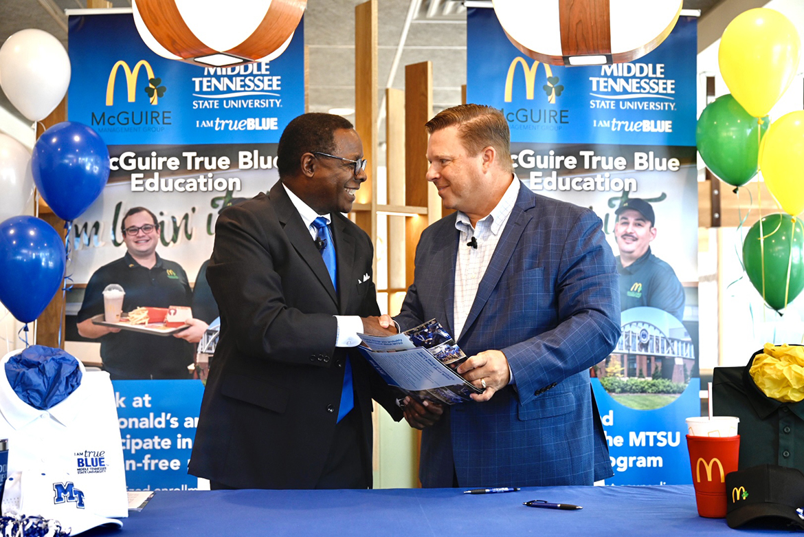 MTSU President Sidney A. McPhee, left, and McGuire Management Group owner/operator Jonathon McGuire shake hands after signing the McGuire True Blue Education Partnership MOU Wednesday, Aug. 4, at the McDonald's franchise on Memorial Boulevard. The agreement calls for McGuire employees to attend MTSU tuition-free if they meet qualifying criteria. (MTSU photo by J. Intintoli)