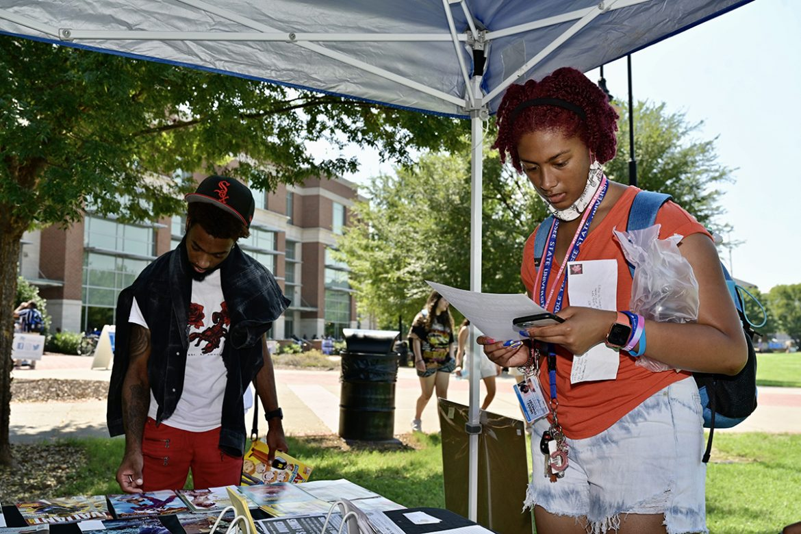 MTSU sophomore biochemistry major Jacorrion Hill, left, of Memphis, Tenn., and freshman film and video production major Chelbi Talley of Memphis check out the comic books and other items available to students at The Great Escape table Tuesday, Aug. 24, at Meet Murfreesboro in the Student Union Commons. The event will take place from 11 a.m. to 3 p.m. Wednesday, Aug. 25, at the same location. (MTSU photo by Andy Heidt)