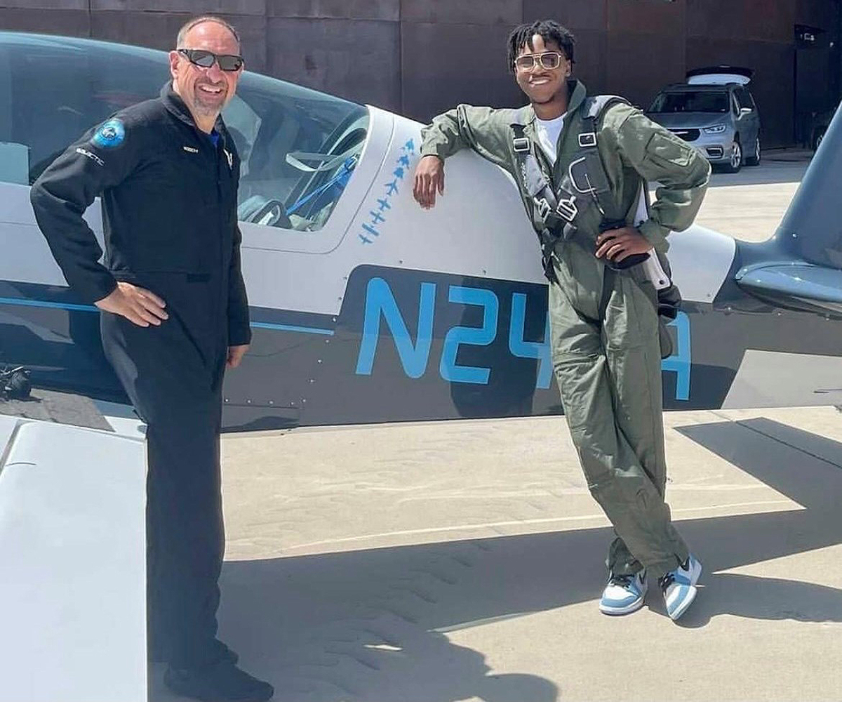 """MTSU junior Mike Harris, right, of Americus, Ga., visits with pilot and mentor Michael """"Sooch"""" Masucci in front of the Extra 300 plane at Spaceport America in the New Mexico desert. Harris , an MTSU aerospace pro pilot major, was selected by Virgin Galactic for a 12-week internship. (Submitted photo)"""